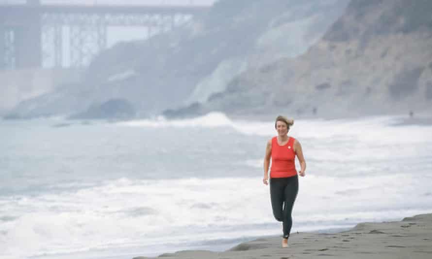 Joan Ullyot running on the beach near her home in San Francisco, California, in 1985.