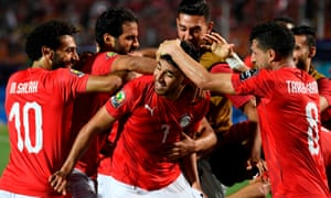 Egypt's Mahmoud 'Trezeguet' Hassan celebrates after scoring against Zimbabwe.