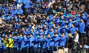 Students from the Ichiritsu Funabashi High School support their team.