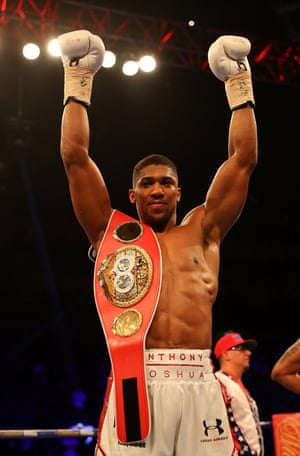 Anthony Joshua celebrates after defeating Dominic Breazeale and retaining his IBF World Title.