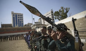 Houthi rebel fighters display their weapons