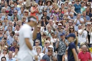 Federer fans applaud their man.