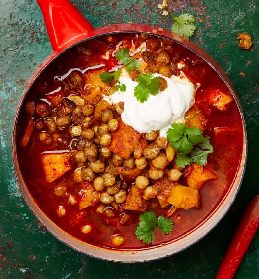 Roasted pumpkin soup with harissa and crisp chickpeas