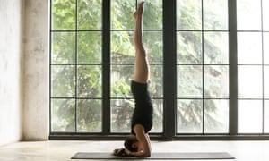 When you're over your head ... a yogic headstand.