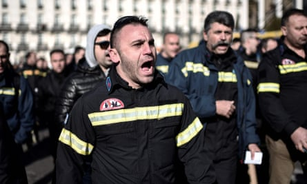 Firemen protest at government austerity measures outside parliament in Athens.