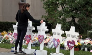 A woman stands at a memorial outside the Tree of Life synagogue in Pittsburgh, Pennsylvania