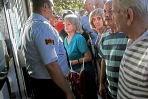 People line up outside a National Bank branch in Athens - as banks opened this morning.