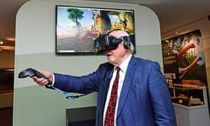 Sir David Attenborough feeds a sauropod in the virtual reality exhibit at the Yorkshire's Jurassic World exhibition in York