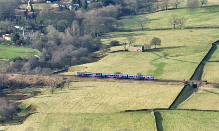Train in landscape near Edale, Peak District, Derbyshire, UK.