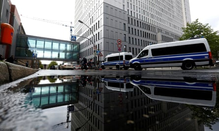 Police vehicles parked outside the Charité hospital complex in Berlin.