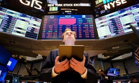 Traders on the floor of the New York Stock Exchange on Monday as stocks slumped