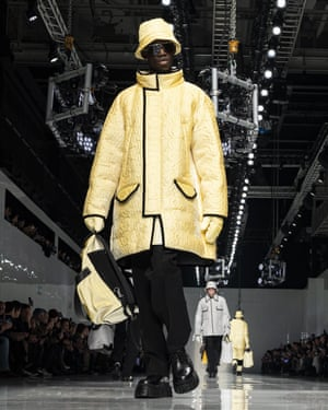 FendiThere was a lot to unpack at Fendi, maxi skirts for men, cropped jumpers, bags that riff on the yellow Fendi carrier bags, knitted bags and coats that change colour. The latter part of a collaboration with Japanese designer Anrealage, the first designer to utilize UV sunlight for fabric colour changing technology in 2013. For this collection Fendi employed the technology on four looks of sporty outerwear and accessories that changed from white to Fendi yellow and from white to black when exposed to UV Sunlight.