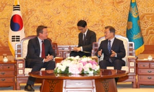 South Korean President Moon Jae-in, right, talks with former UK prime minister David Cameron at the presidential Blue House in Seoul, South Korea