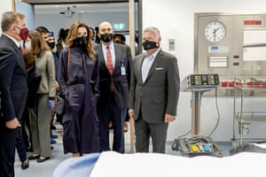 A handout picture released by the Jordanian Royal Palace on 16 August, 2020 shows Jordanian King Abdullah II (C-R) accompanied by his wife Queen Rania (C-L), as they and their entourage are clad in masks due to the coronavirus pandemic, while inaugurating a new emergency hospital in the capital Amman.