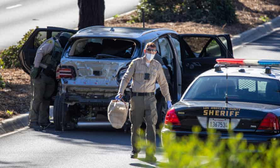 LA county deputies gather evidence from Woods's car after the accident.