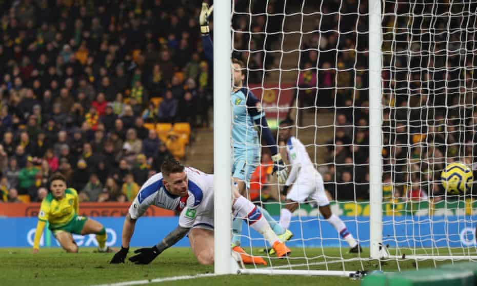 Connor Wickham scores Crystal Palace's late equaliser from close range at Carrow Road on New Year's Day.