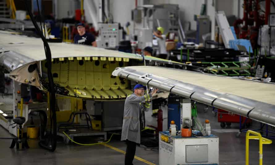 A worker inspects an aeroplane wing in the Bombardier factory in Belfast, Northern Ireland.