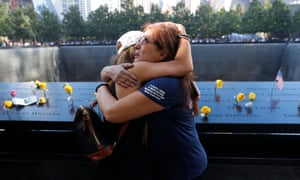 Melinda Moran and Haydee Lillo embrace after finding out they lost people who knew each other, next to the North Reflecting Pool at the National September 11 Memorial.