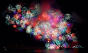 A long exposure image of fireworks exploding during the 2015 Kumano O-Hanabi fireworks festival in Japan.