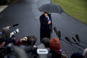 Donald Trump speaks to members of the media before boarding Marine One at the White House in Washington on 2 December 2019.
