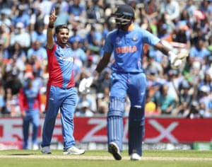Afghanistan's Aftab Alam, left, celebrates the dismissal of India's Hardik Pandya, righ.