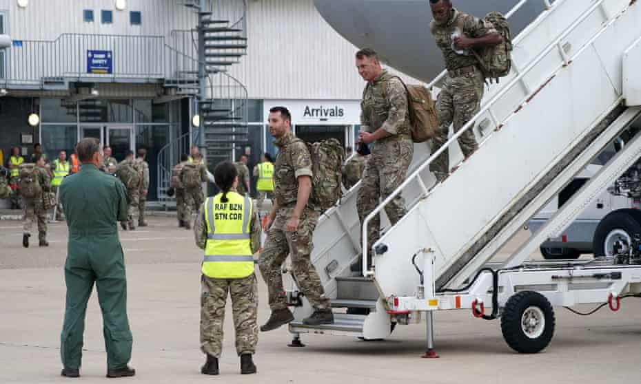 Members of the British armed forces disembark at RAF Brize Norton, west of London, as the troops and diplomatic staff return from assisting with the evacuation.