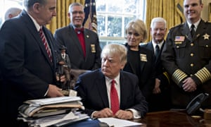 Donald Trump meets with county sheriffs in the Oval Office of the White House in Washington on Tuesday.