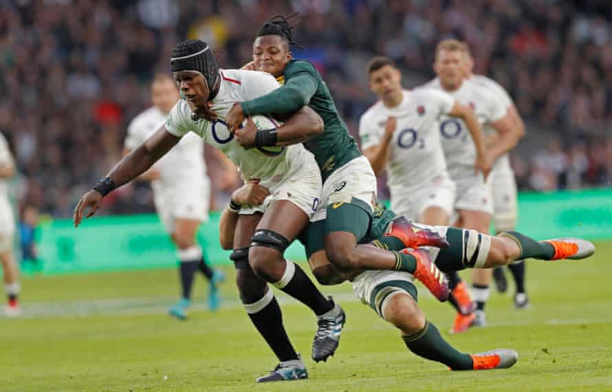 Maro Itoje of England is tackled by Sbu Nkosi and Duane Vermeulen during the England v South Africa autumn international rugby union match at Twickenham Stadium in November 2018