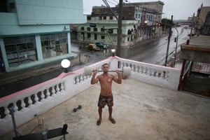 Havana, Cuba Dian Peralta, 24, exercises on the roof of his home