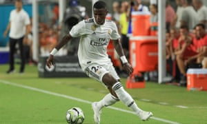 Vinicius Junior dribbles against Manchester United.