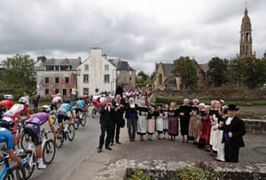Stage 1: Villagers in traditional costume perform for the peloton in Brest
