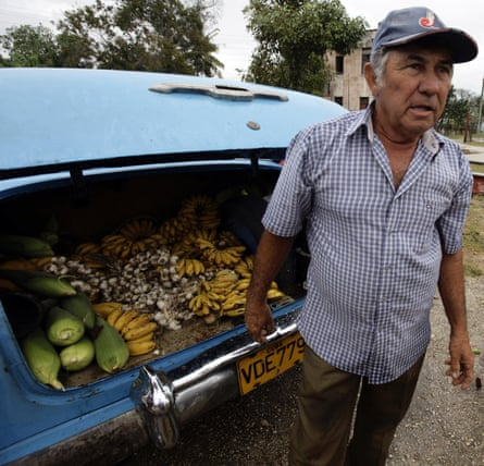 A farmer sells his produce out of the boot of his car at a market in the village of Sagua La Grande in central Cuba.