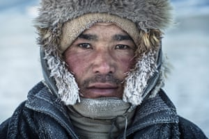 A Kazakh man wrapped up for the trek