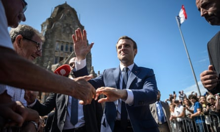 The French president, Emmanuel Macron, greets members of the public on voting day in Le Touquet.