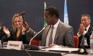 Dr Vincent Biruta, Rwandan government minister, hits a hammer to symbolise the adoption of the Kigali amendment on 15 October 2016.