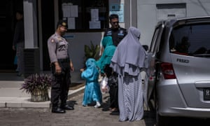 Relatives of death row prisoners arrive at Wijayapura port to visit Nusa Kambangan prison on Thursday.