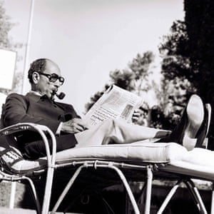 """Egyptian President """" Sadat"""" reads daily newspapers at his home in Giza, 1978"""
