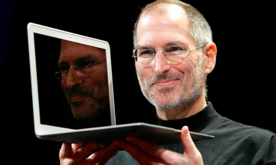 Steve Jobs holds up the new MacBook Air at a conference in 2008.