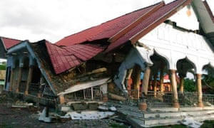 A badly damaged building is seen after a 6.5-magnitude earthquake struck the town of Pidie in Indonesia's Aceh province.