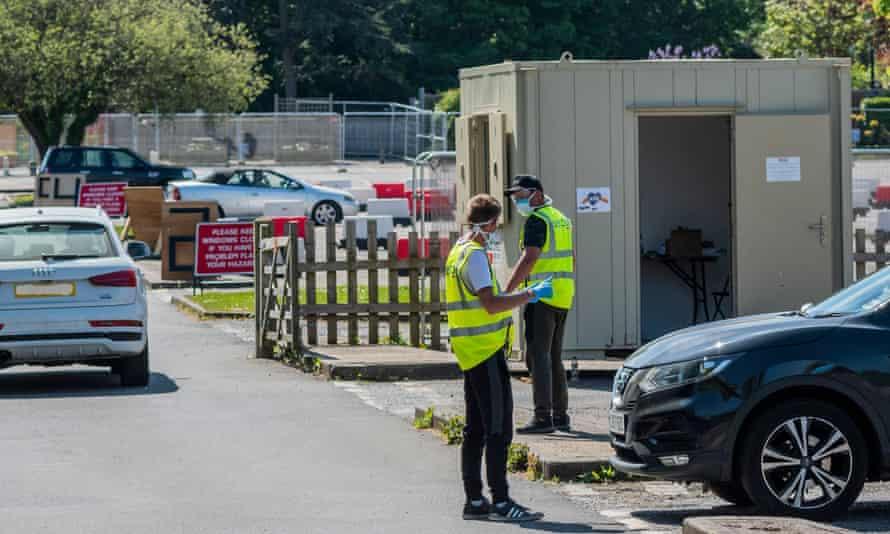 Staff in Serco bibs at a drive-through coronavirus testing facility near Epsom.