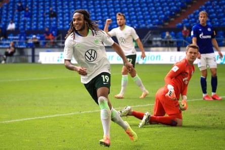 Wolfsburg's Kevin Mbabu celebrates after scoring against Schalke 04.
