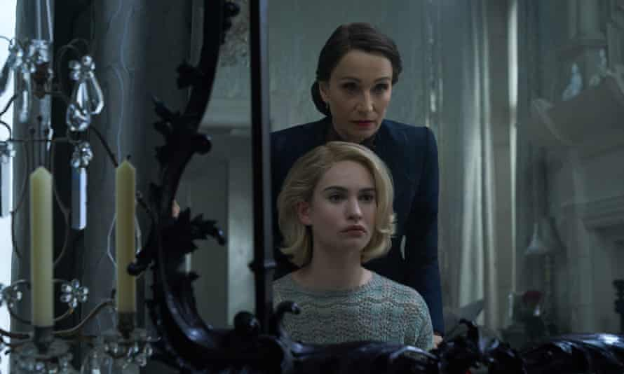 Trickery … Kristin Scott Thomas as Mrs Danvers and Lily James as Mrs De Winter.