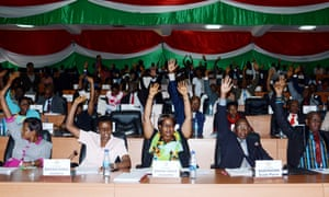 Members of Burundi's parliament raise their arms to vote in Bujumbura on Wednesday.