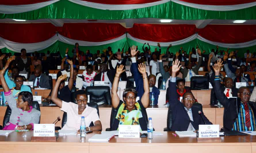 Members of Burundi's parliament raise their arms to vote in Bujumbura on Wednesday.