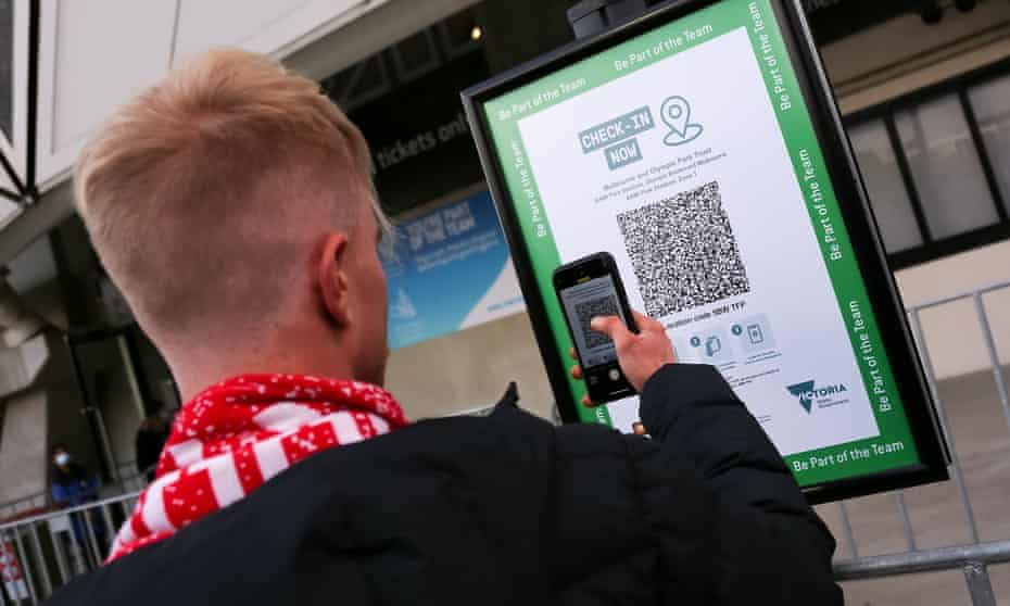 A man checks in with the Covid QR code at AAMI Park in Melbourne, Australia