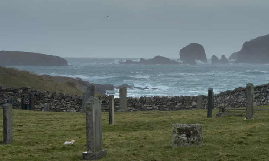 Island graves beside a stormy sea