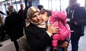 A Syrian refugee with her child.
