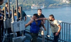 A civilian beats a soldier