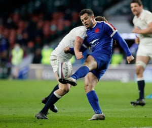 Owen Farrell of England attempts to charge down Brice Dulin of France.