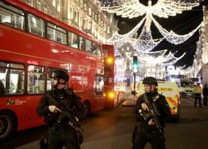 False alarm … police officers near Selfridges on Oxford Street, London.